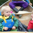 young children canoeing