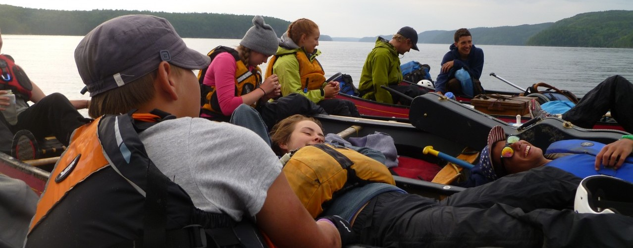 campers take a break in their canoes
