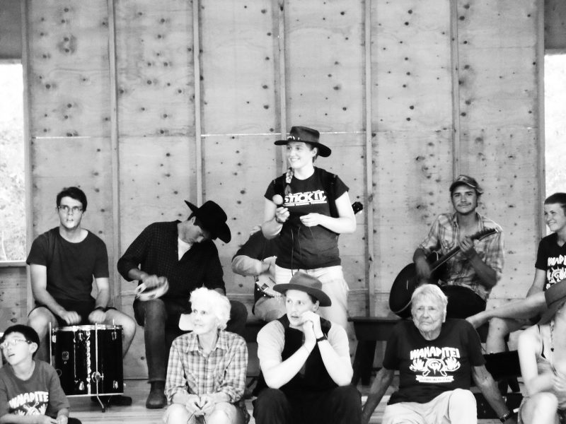 band and caller on stage of new activity centre during square dance